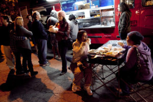 People enjoy food trucks at the California Heritage Museum's Tuesday food truck court.