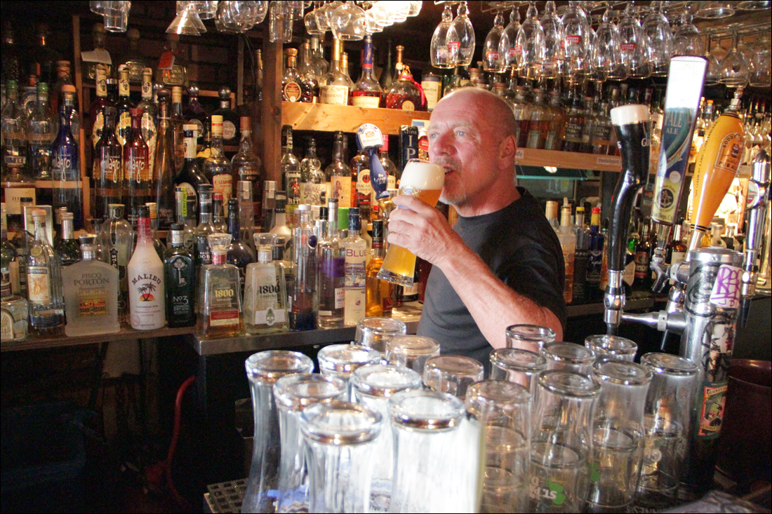 JUST A TASTE: Owner of the Daily Pint Phil McGovern has a sip of a beer at his Pico Boulevard watering hole.
