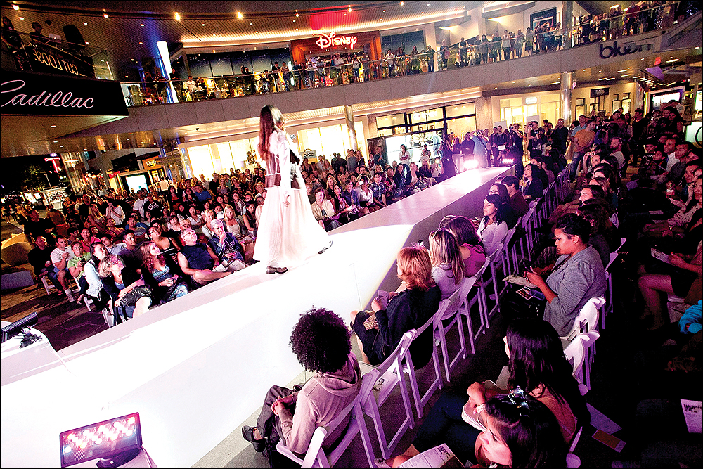 STRUTTING HER STUFF: A model walks down the runway at Santa Monica Place during last year's Fashion's Night Out. (File photo)