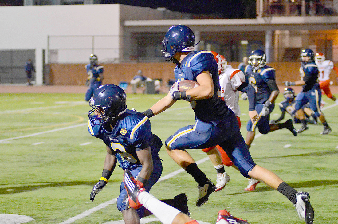 ON HIS WAY: Matt Rusk-Kosa leaps over a defender after intercepting the ball, eventually running it back for a touchdown last week against Redondo Union at Santa Monica College.