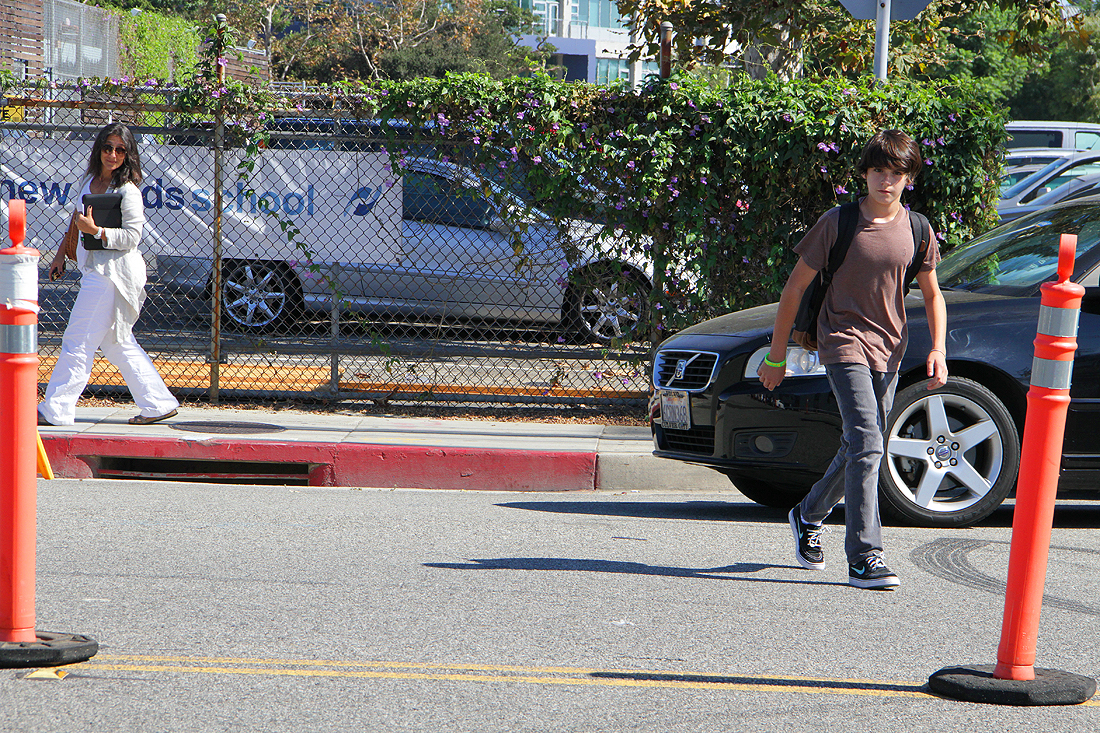 WAY OF THE WALK: A New Roads student crosses Nebraska Avenue at Berkeley Street on Tuesday after school.