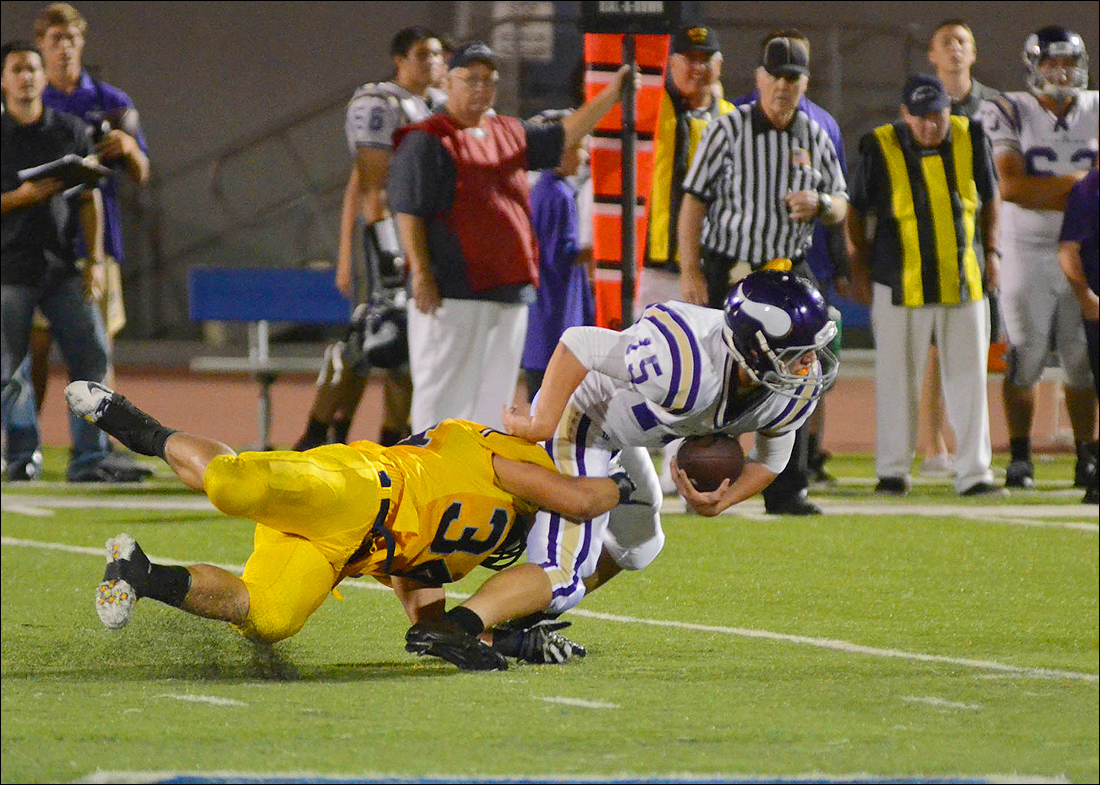 GOT 'EM: Samohi's Nick Cardiel sacks Valencia quarterback Sean Murphy last week. (Photo by Paul Alvarez Jr.)