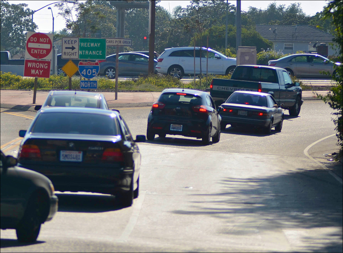 PILING ON: Cars line up to enter the I-405 Freeway on Thursday. (Photo by Paul Alvarez Jr.)