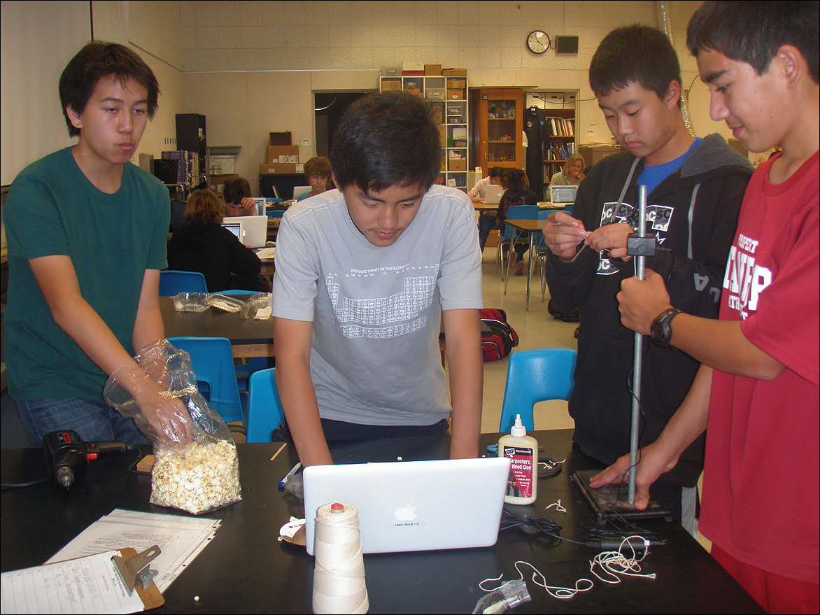 A student team figuring out how to use a force sensor.