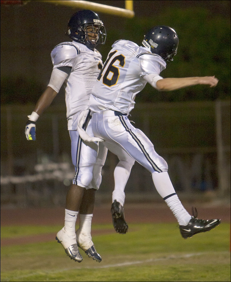 GETTING UP: Santa Monica High School quarterback Jordan Detamore (16) and  wide receiver Sabastian LaRue (1) celebrate in the end zone after a LaRue touchdown against Morningside High School on Friday at Coleman Stadium. Samohi would go on to win the game, 35-20. (Photo by Michael Yanow)