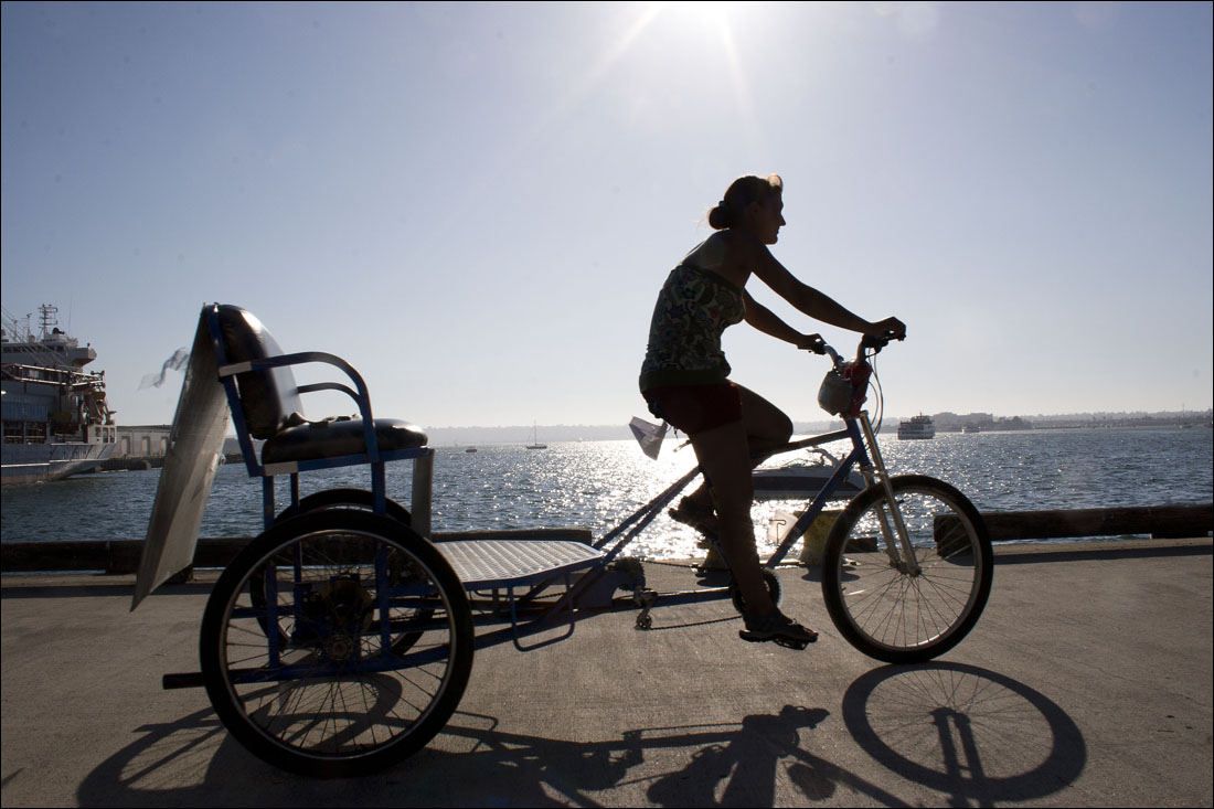 JUST RIDE: A pedicab operator pedals along the San Diego coast. A business wants to set up a similar operation in Santa Monica. (Photo by Abe Wischnia/WordPress)