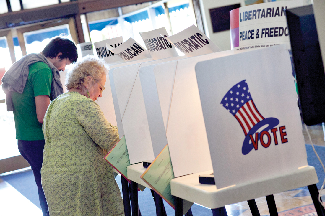 People vote during a recent election. (File photo)