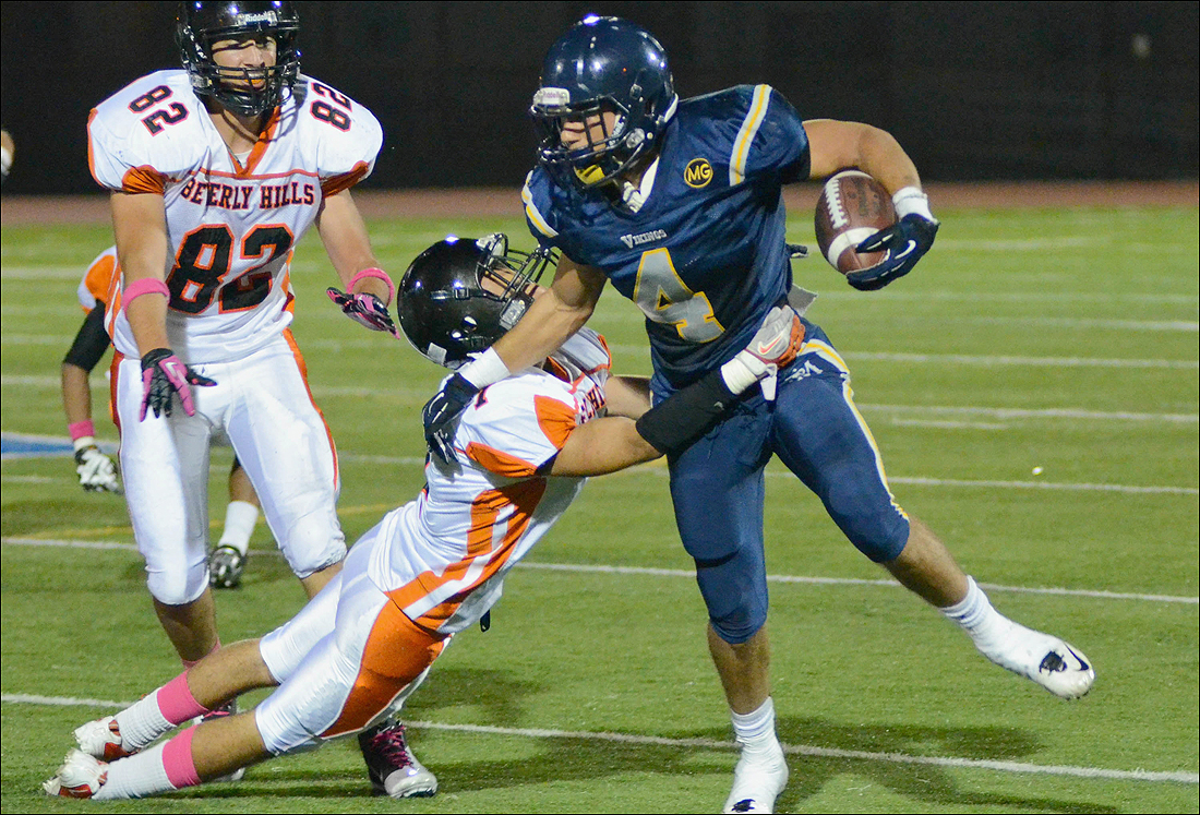 Samohi running back Russell Revis runs for a gain against Beverly Hills last week. (Photo by Paul Alvarez Jr.)