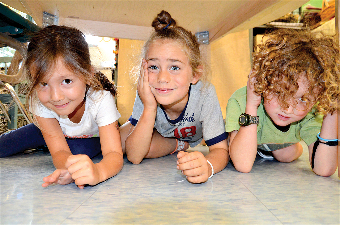 First-grade students take cover underneath their desks during the 'Great California Shakeout' at Santa Monica Alternative School House (SMASH) on Thursday. The fifth annual earthquake drill is intended to remind people to be prepared for a natural disaster. About 9.3 million people registered to take part in the drill statewide. (Photo by Fabian Lewkowicz)