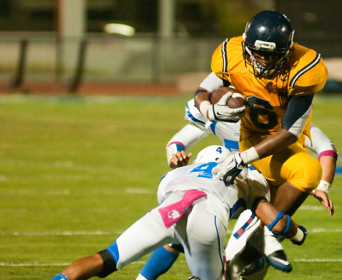 Samohi running back Yachal Butler runs for a gain against Culver City on Friday at Corsair Field. (Photo by Morgan Genser)
