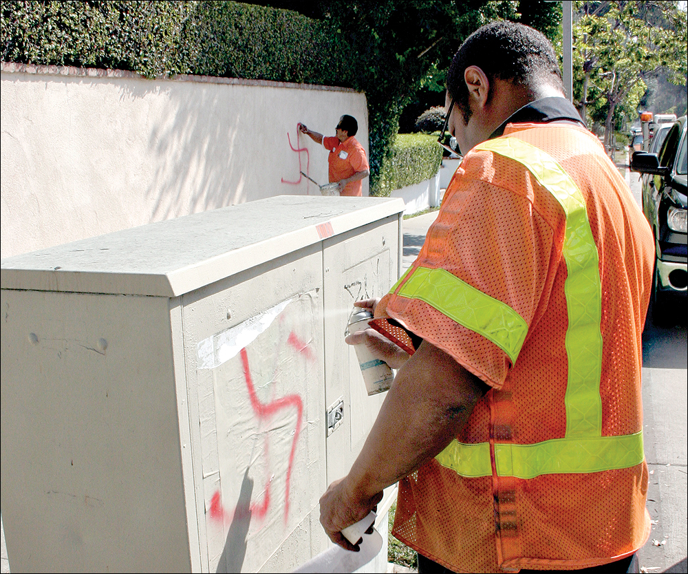 A SIGN? Swastikas are removed last year near Georgina Avenue and Seventh Street. (Photo by Kevin Herrera)