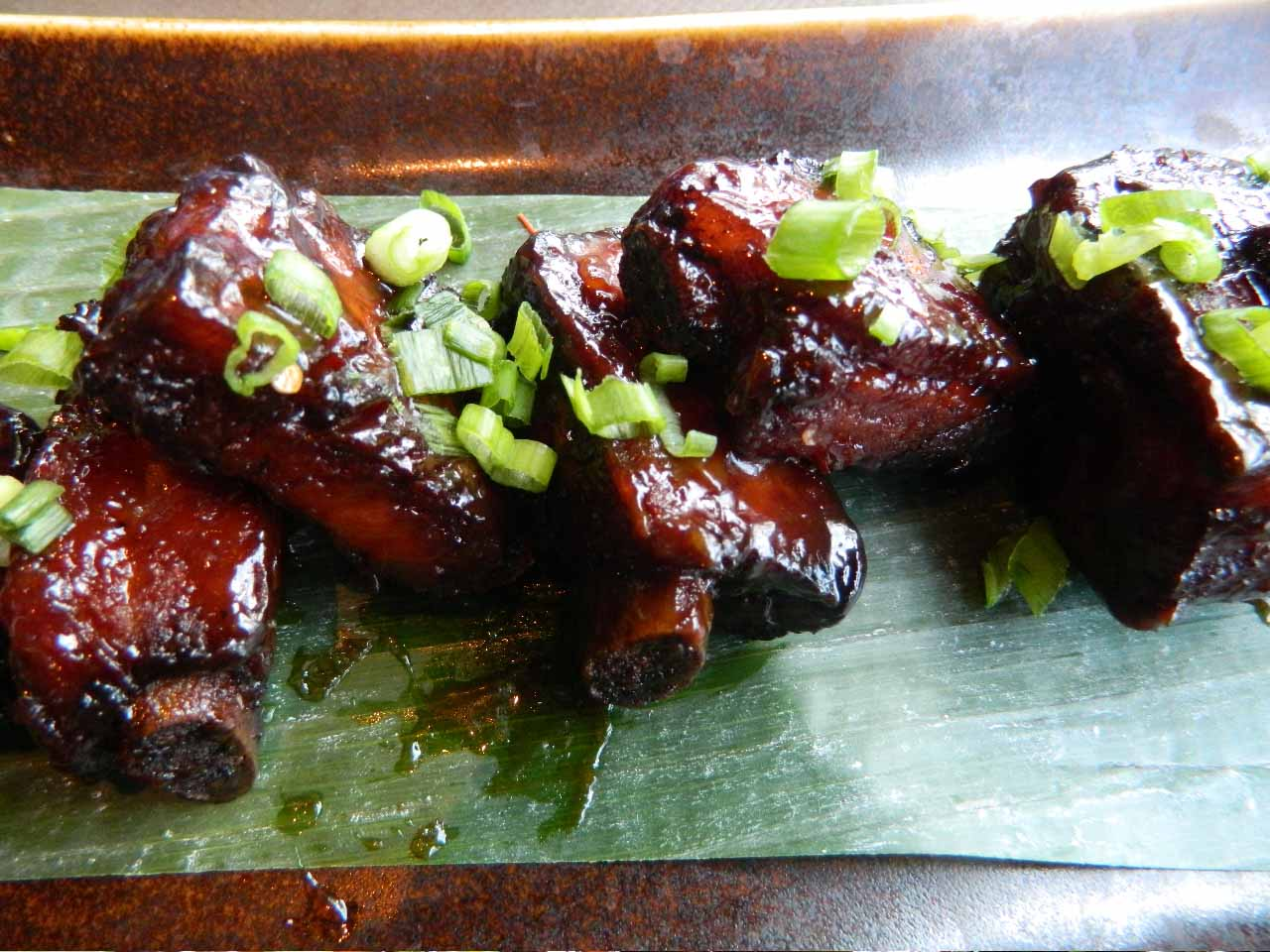 Lacquered BBQ ribs in a chili-caramel-sesame marinade shows off the chef's penchant for sweet at Rock Sugar. (Photo by John Blanchette.)