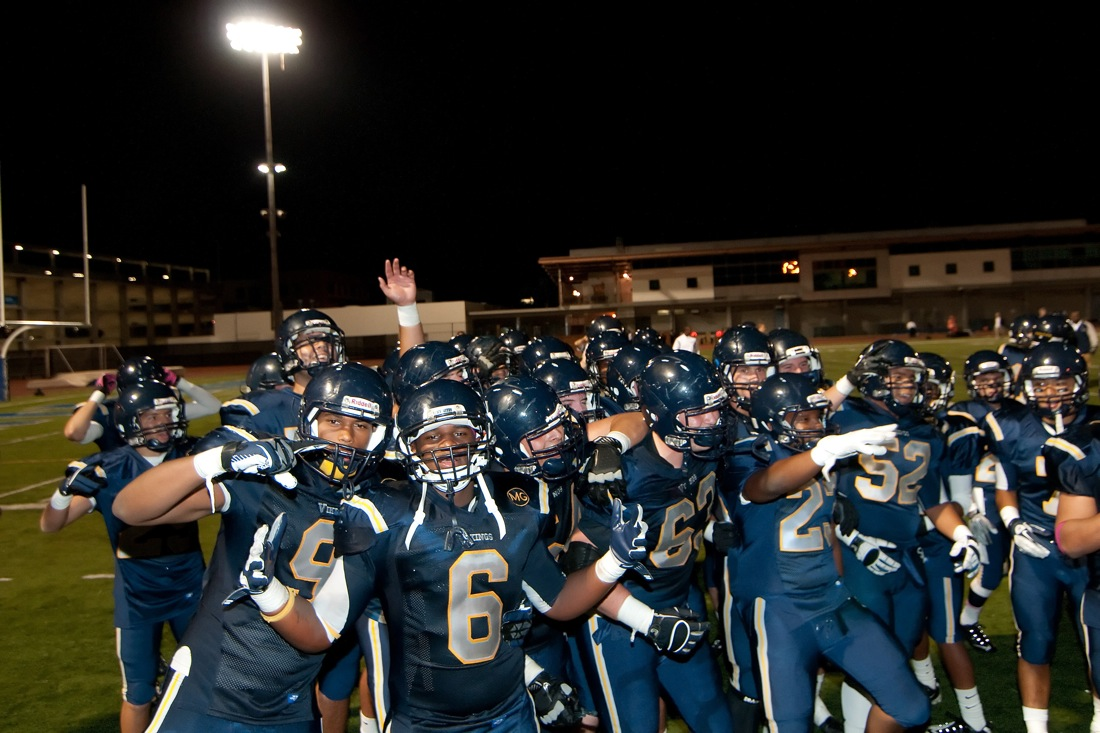 Samohi football team celebrates after beating Beverly Hills on Friday. (Photo by Morgan Genser)