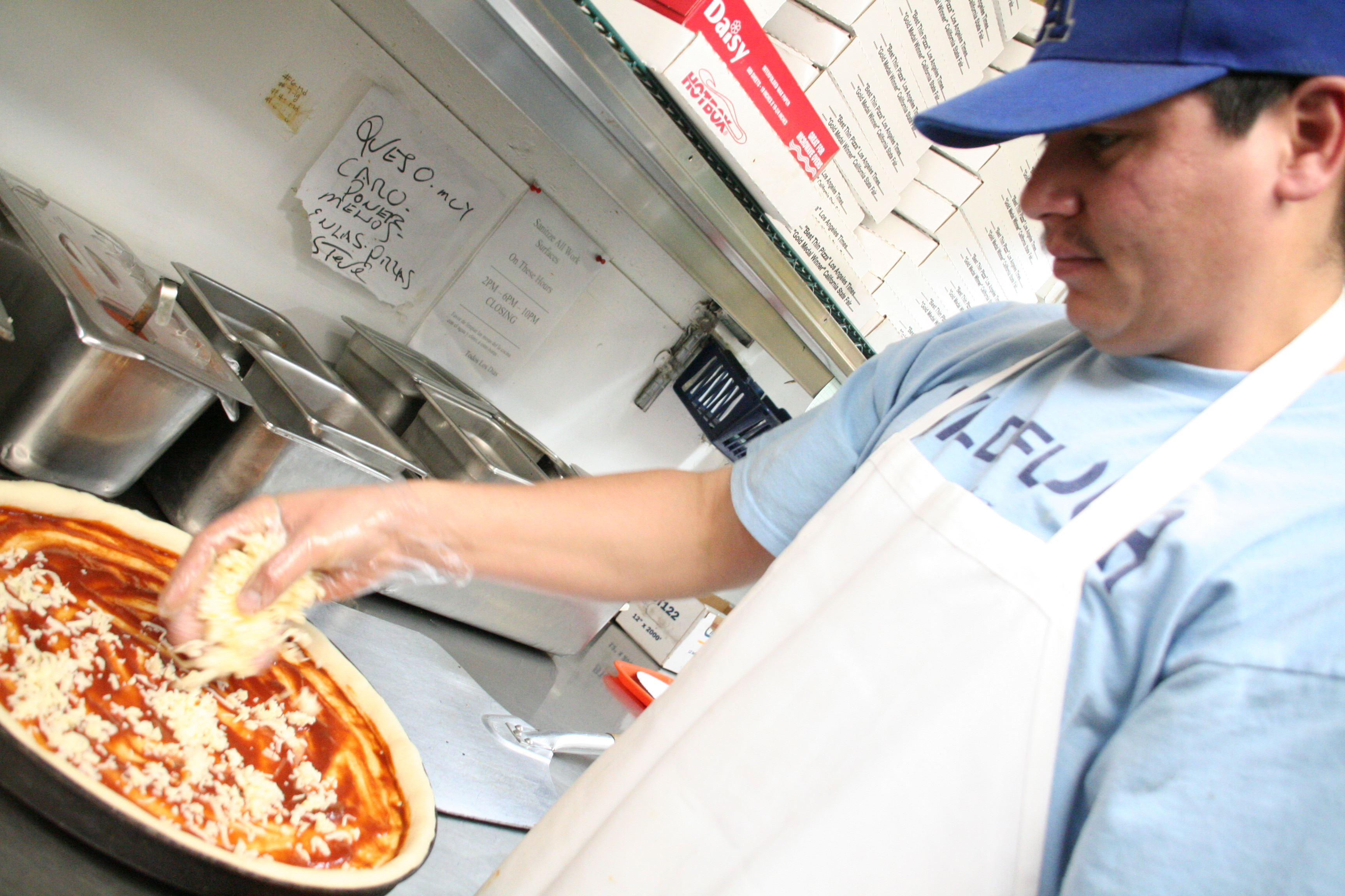 Luis Romo prepares a pie at Wildflour, once voted the number one pizza place in Los Angeles by the L.A. Times.
