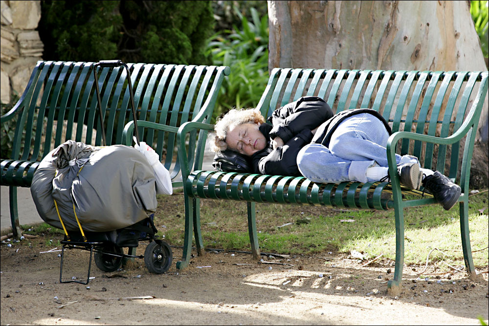 A homeless woman sleeps in Palisades Park. (Photo by Daniel Archuleta)