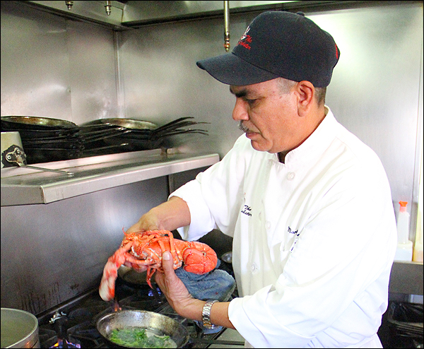 Sous chef Martin Cervantes prepares lobster at The Lobster on Tuesday. (Photo by Daniel Archuleta)