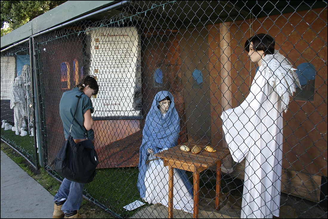 A woman stops to view one of the three nativity scenes in Palisades Park last year. (Photo by Daniel Archuleta)