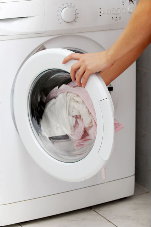 CLEAN RINSE: Three steps to a healthier, greener laundry room: Use natural, nontoxic detergents free of harsh chemicals, dyes and perfumes; lose the fabric softener in favor of vinegar; and swap out your old equipment for EnergyStar rated appliances that are more energy-efficient and will save money over time. (Photo courtesy iStockPhoto/Thinkstock)