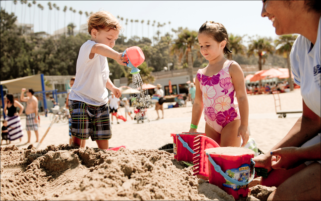 Children play in the sand at the Annenberg Community Beach House. (File photo)