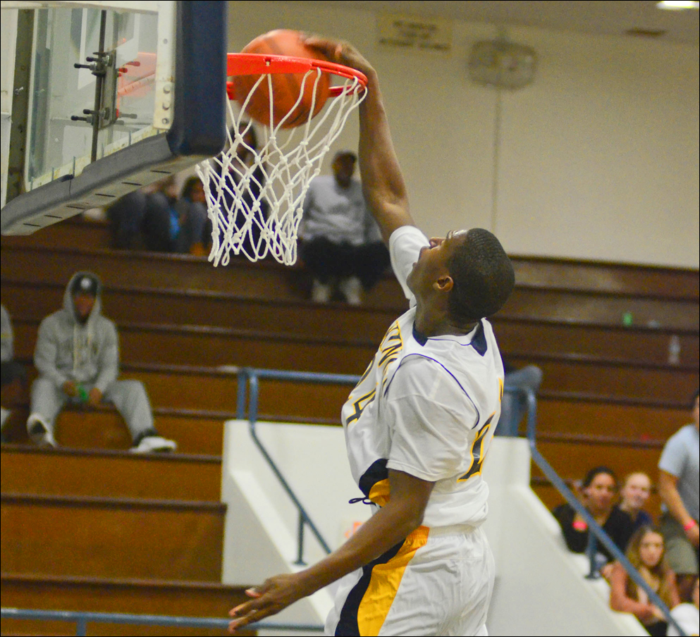 Samohi's Jordan Mathews slam dunks against Oaks Christian on Monday at home. (Photo by Paul Alvarez Jr.)