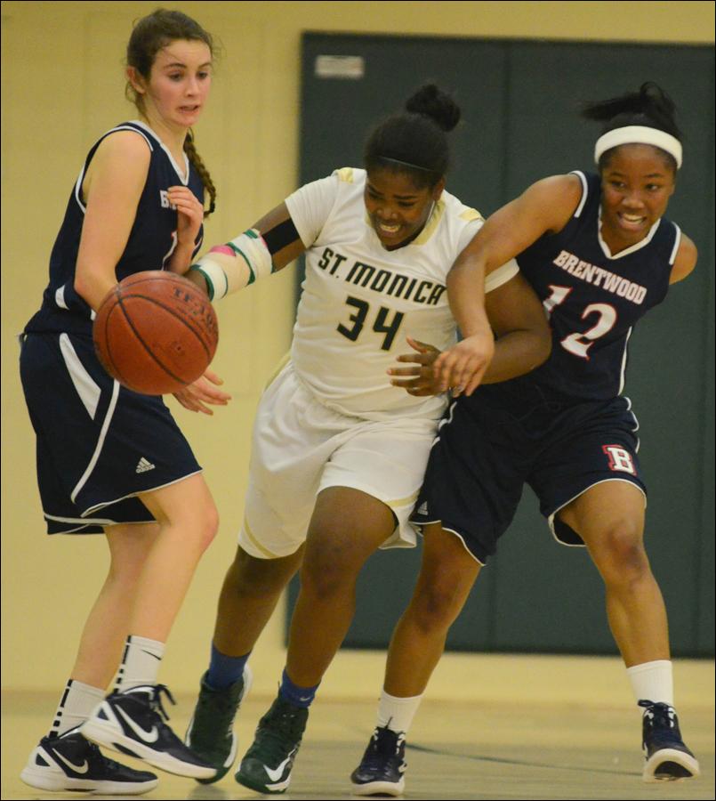 St. Monica's Briana Harris powers past a pair of Brentwood defenders on Tuesday. (Photo by Paul Alvarez Jr.)