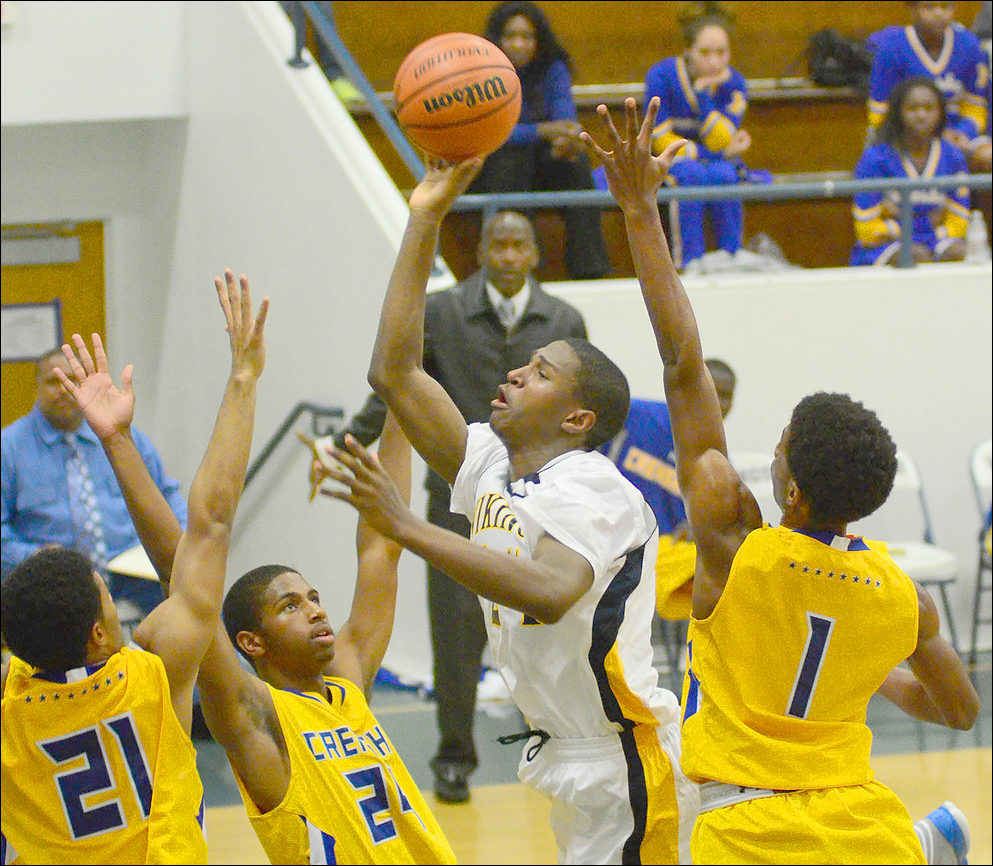 Samohi's Jordan Mathews drives to the basket among a crowd of Crenshaw defenders on Wednesday. (Photo by Paul Alvarez Jr.)