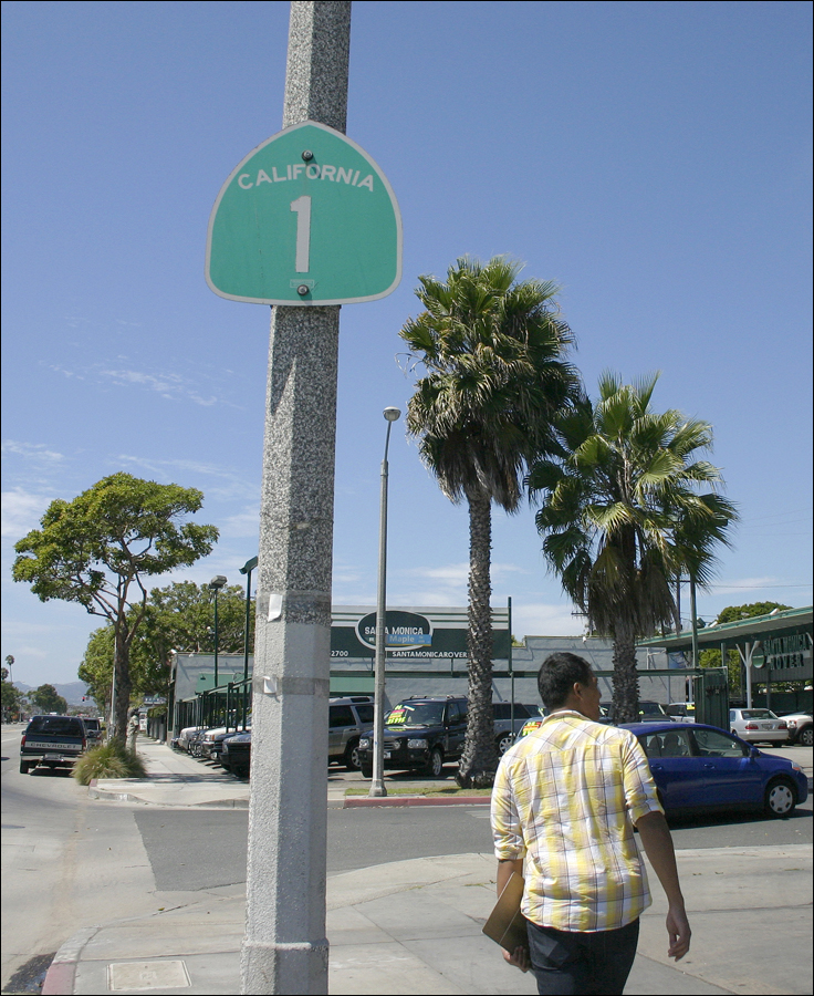 A man walks by the Pacific Coast Highway sign on Lincoln Boulevard. (File photo)