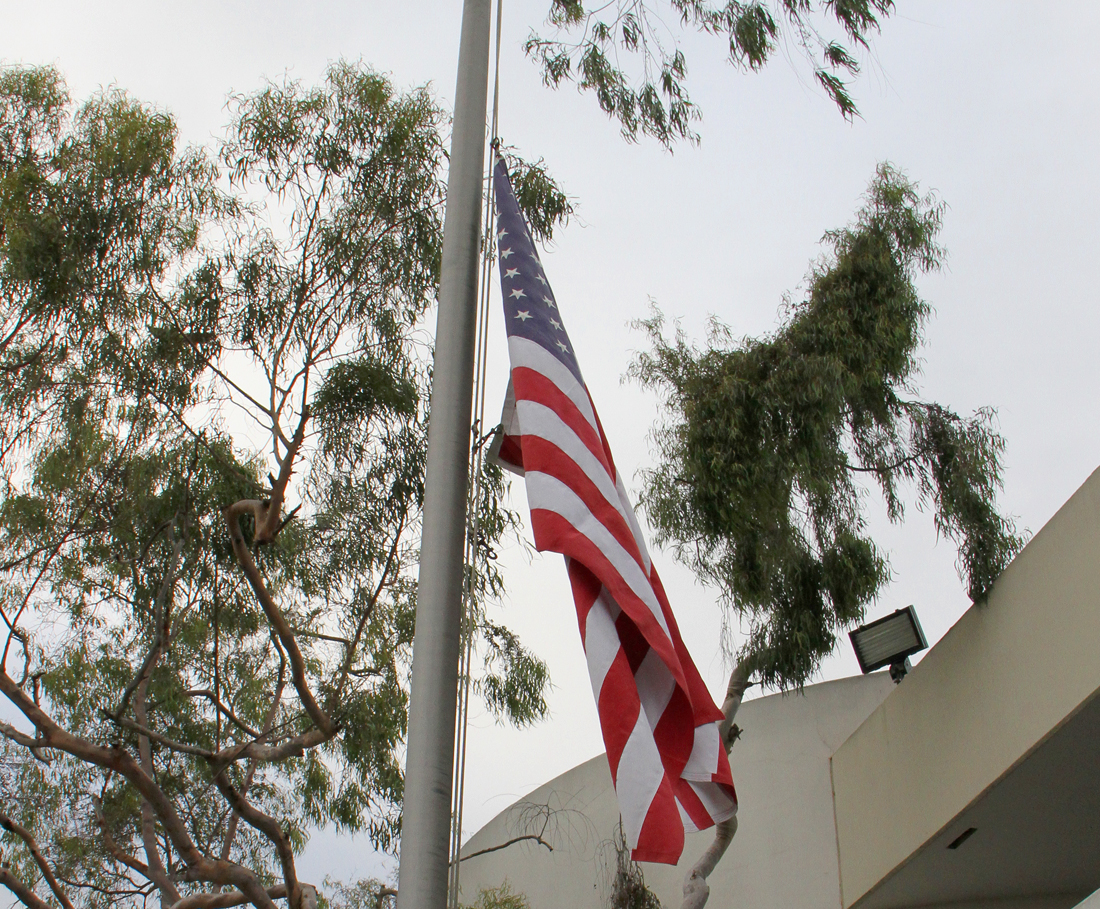 The American flag in front of the Santa Monica-Malibu Unified School District Headquarters was flown at half-mast Monday in memory of the victims of the school shooting in Newtown, Conn. (Photo by Daniel Archuleta)