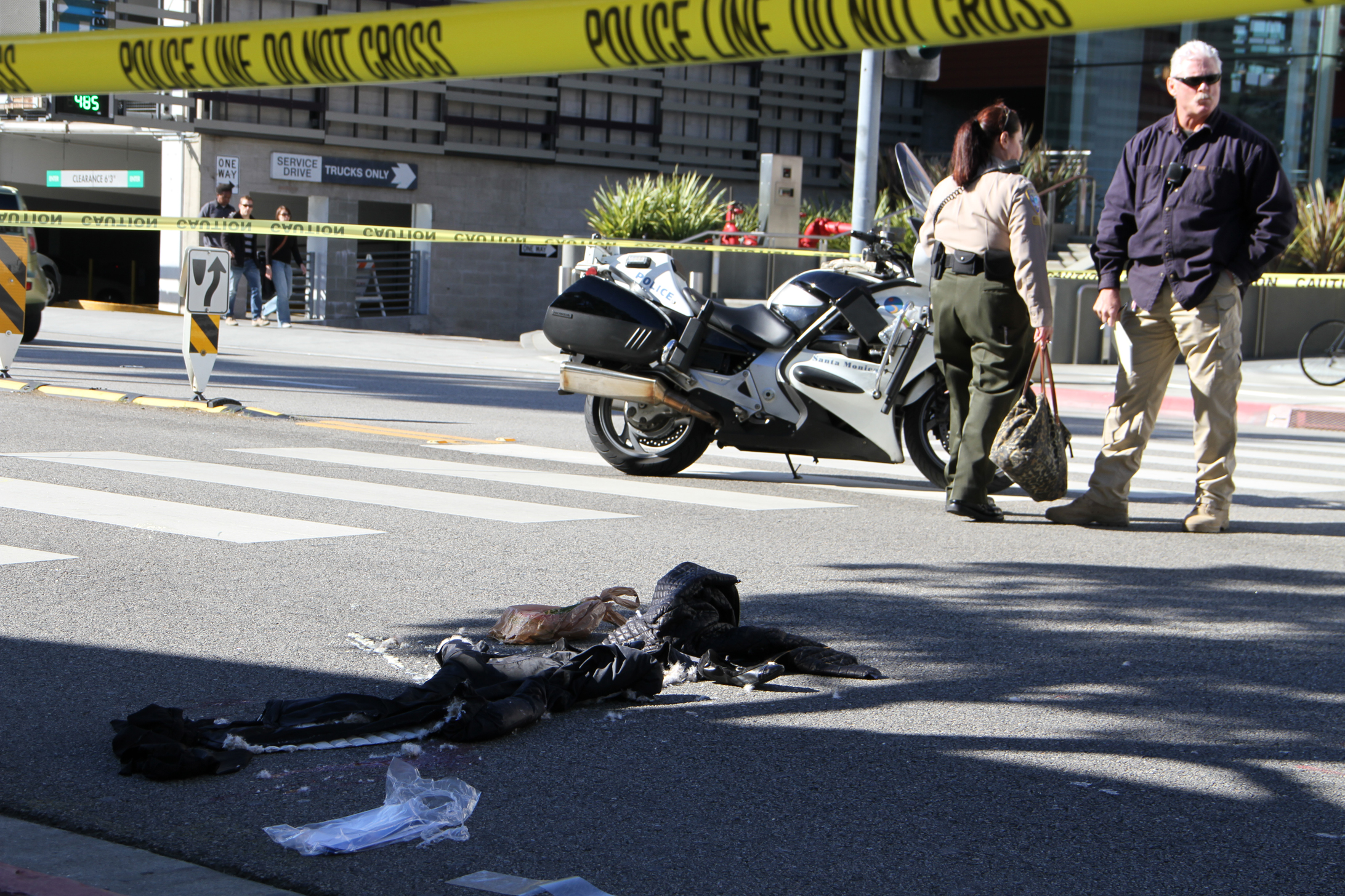 Police investigate a collision Wednesday involving a pedestrian who was hit by a car while crossing Colorado Avenue near Santa Monica Place mall. (Photo by Kevin Herrera)