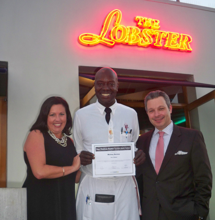 Mickey Barnes (center), a server at The Lobster, was recently recognized for his years of providing great service to diners. (Photo courtesy Santa Monica Convention & Visitors Bureau)