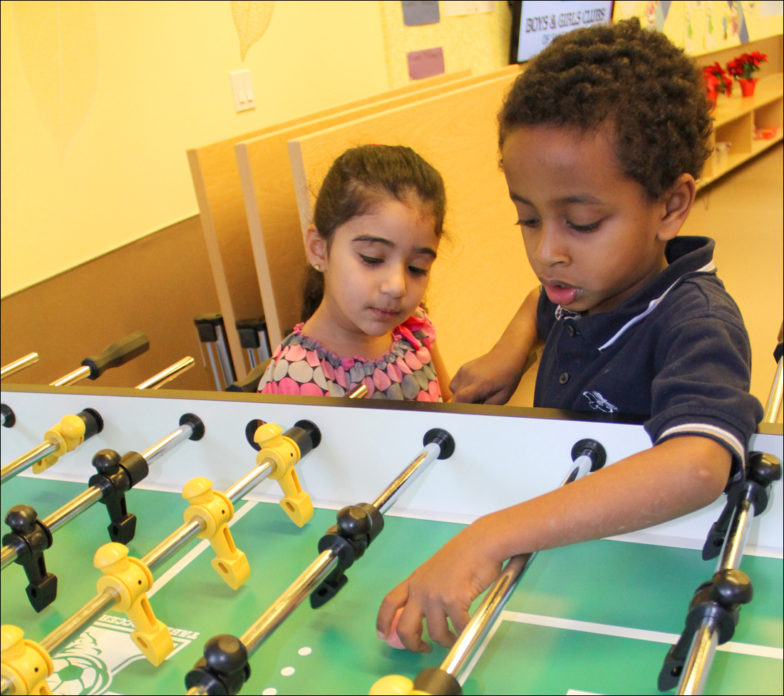 GAME ON: A pair of kids play foosball during the opening in December of a Boys & Girls Clubs of Santa Monica branch in a Community Corp. of Santa Monica building on Broadway. (Photo by Daniel Archuleta)