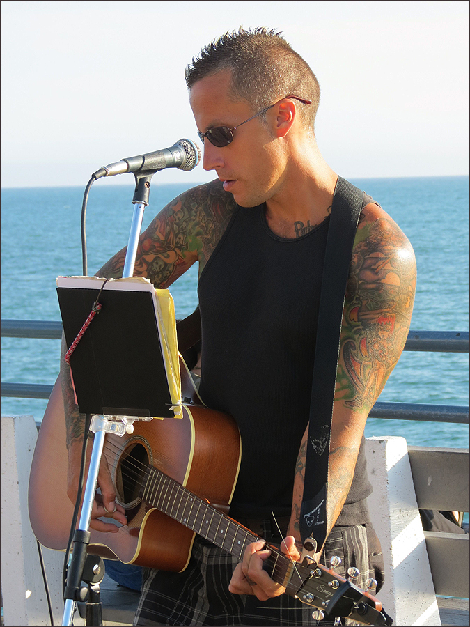 PIER PRESSURE: Casey O'Day went from owning a market to performing on the pier. (Photo courtesy Casey O'Day)