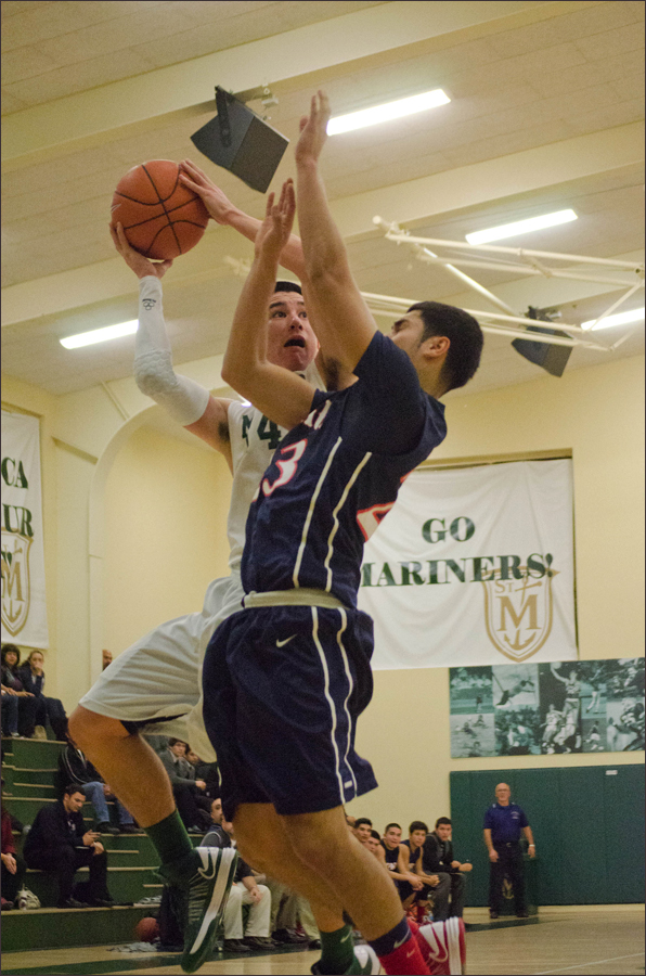 St. Monica's Jack Matsunaga goes up for a lay up against St. Paul on Wednesday. (Photo by Paul Alvarez Jr.)