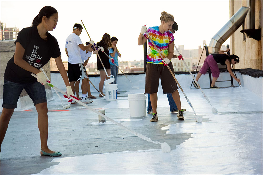 AT WORK: Some 90 percent of U.S. buildings have dark-colored roofs which, when exposed to full sun can increase in temperature by as much as 90 °F. A white roof typically increases temperatures only 10-25 °F above ambient air temperatures during the day. (Photo courtesy White Roof Project)