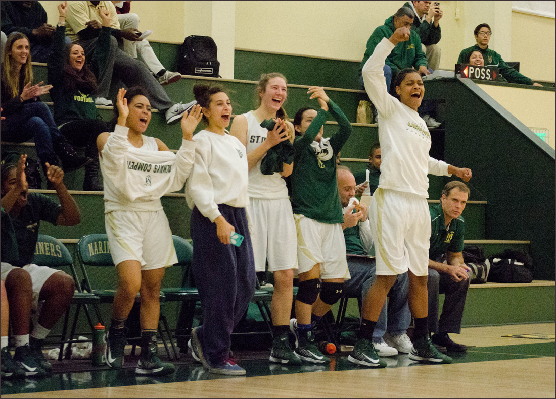 St. Monica's bench roots for their teammates on Tuesday against Mary Star. (Photo by Paul Alvarez Jr.)