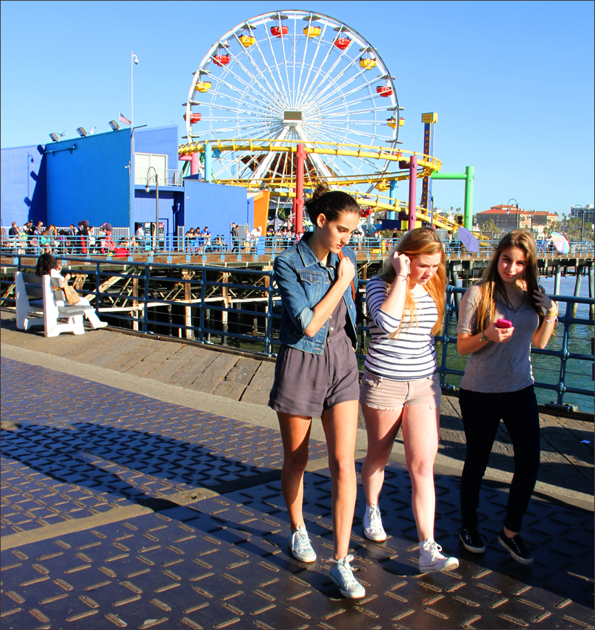 Crowds walk along a portion of the Santa Monica Pier that will receive a major overhaul. (Photo by Daniel Archuleta)