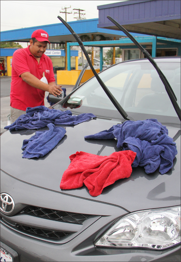 A worker towels off a car at the Wilshire West Carwash on Wednesday. (Photo by Daniel Archuleta)