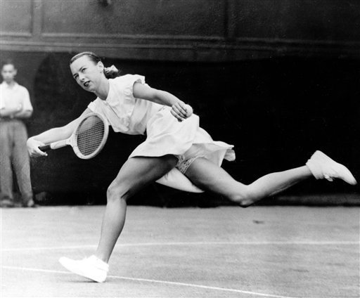 "In a June 22, 1949 file photo, Gertrude ""Gussie"" Moran races across Centre Court to make a return shot in third round women's singles match in Wimbledon, England. Moran, who shocked the modest mid-century tennis world when she took the court at Wimbledon with short skirt and ruffled underwear, died Wednesday in Los Angeles. She was 89. (Photo courtesy Associated Press.)"