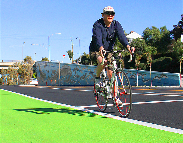 A cyclist rides along the new green bike lane on Ocean Park Boulevard. (File photo)