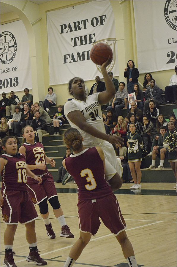 UPS: St. Monica's Briana Harris goes up for a layup against Cantwell-Sacred Heart on Tuesday. (Photo by Alex Vejar)