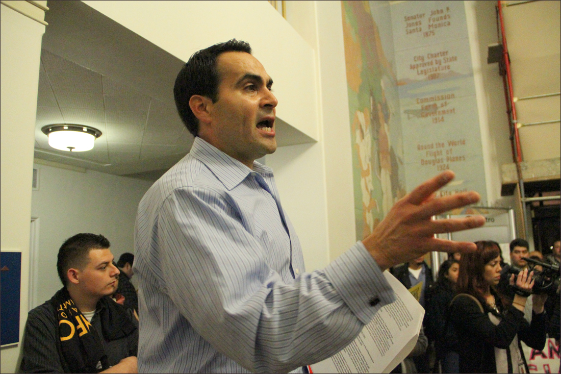 THE SCENE: Pico Youth & Family Center Executive Director Oscar de la Torre speaks to supporters during a rally at City Hall last month. The crowd gathered to speak during a council meeting. (Photo by Daniel Archuleta)