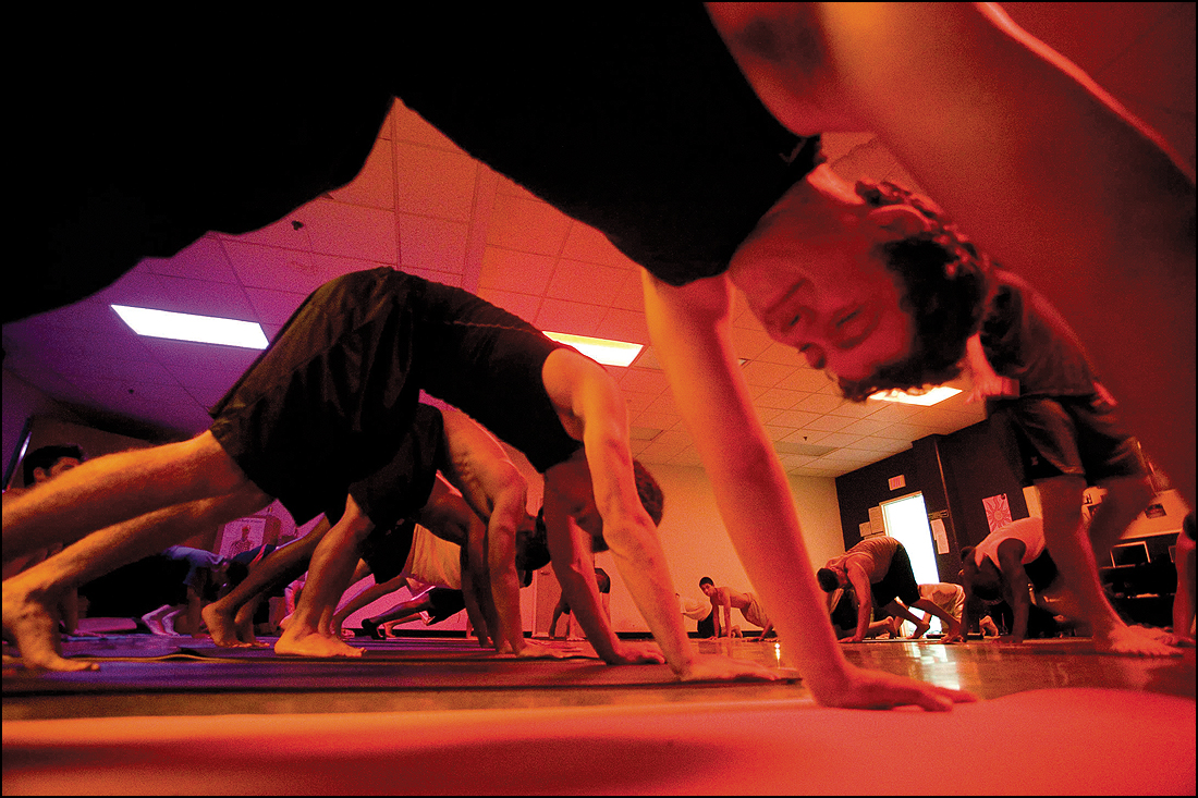 The Santa Monica High School football team goes through an intensive yoga workout with instructor Jason Battung in 2010. (File photo)