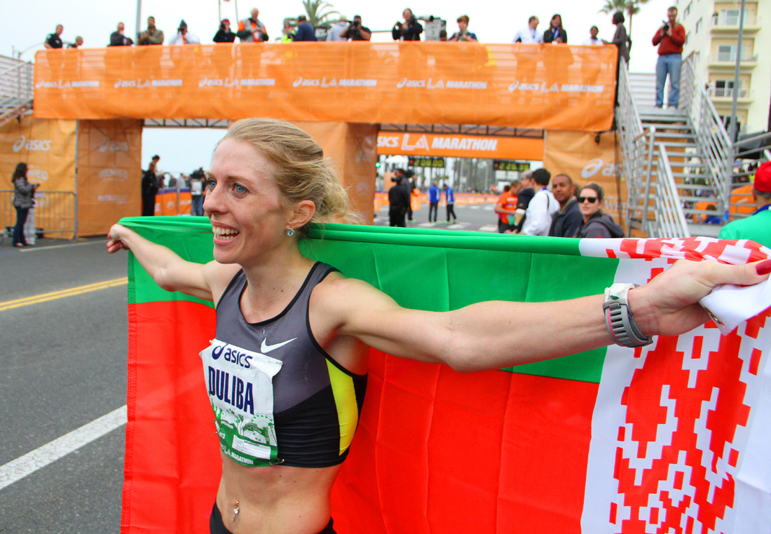 Aleksandra Duliba of Belarus celebrates winning the 2013 L.A. Marathon on Sunday. (Photo by Daniel Archuleta)