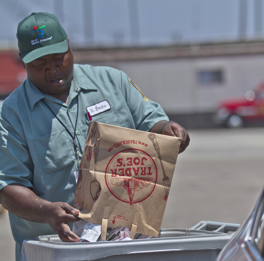 THERE IT GOES: Derwin Banks of Santa Monica's Resource Recovery and Recycling service helps locals shred documents and recycle old electronics at the City Yard last year. (File photo)