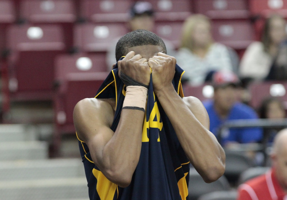 Samohi's Nuwriyl Williams covers his face after the Vikings lost in the state basketball finals on Friday. (Photo by Charles McDonald)