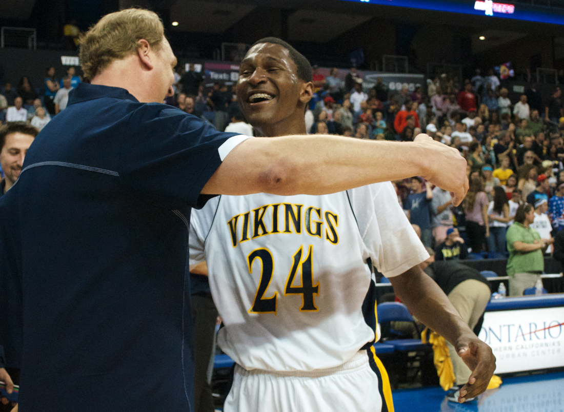 Samohi head coach James Hecht (left) and guard Jordan Mathews celebrate after winning the CIF State Regional final against Loyola on March 16. (Photo by Paul Alvarez Jr.)