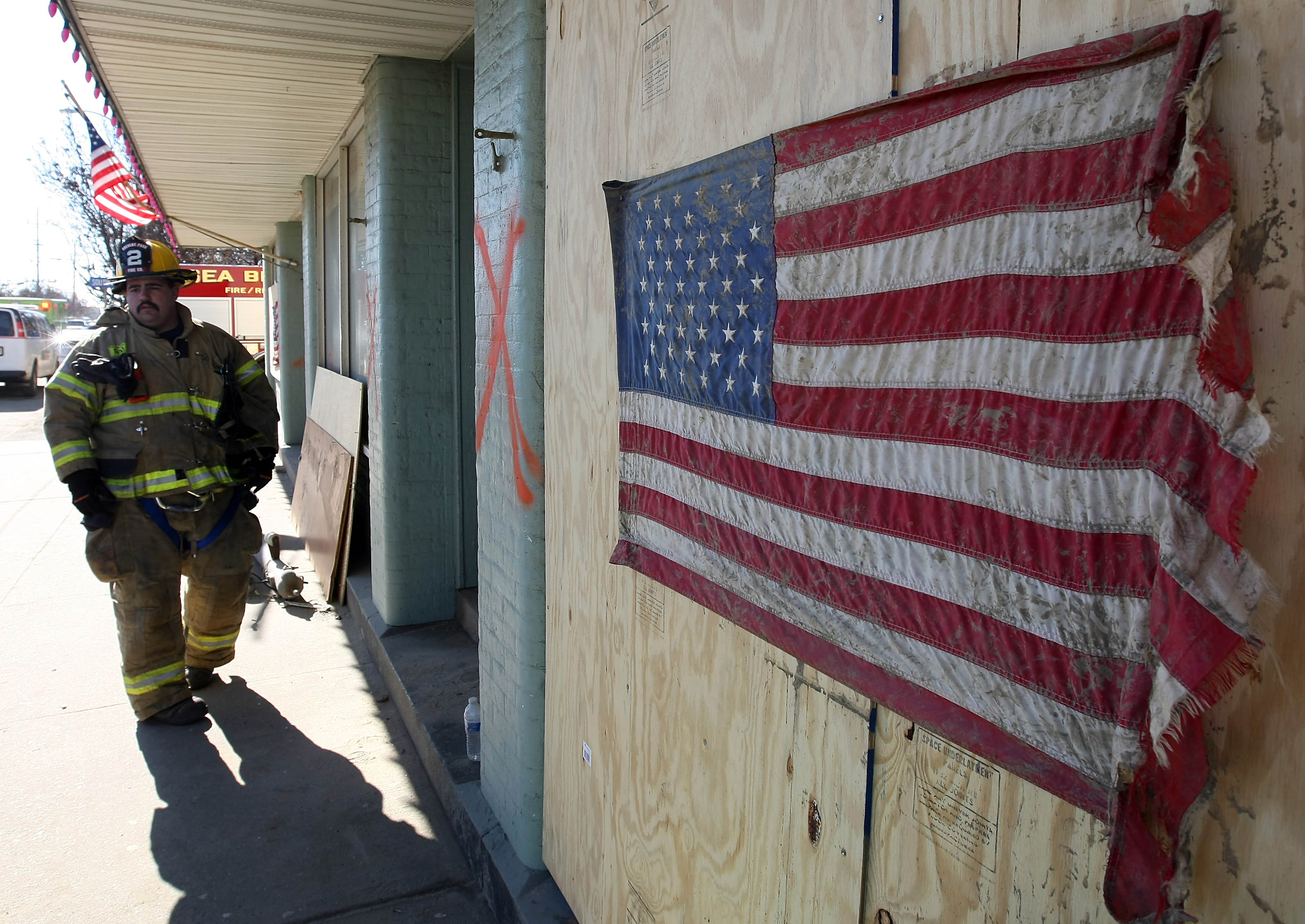 A fire fighter in New Jersey surveys the damage caused by Hurricane Sandy. (Photo courtesy Google Images)