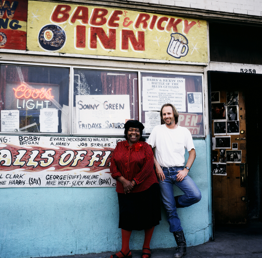 Mama Laura outside the original Babe's & Ricky's Inn on Central Avenue with Jonathan Hodges.