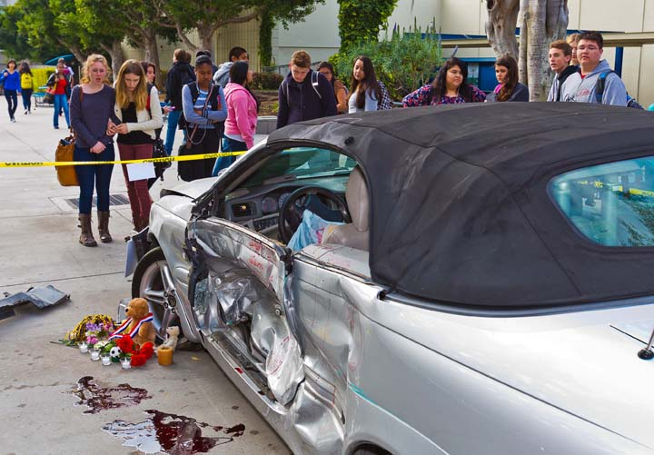 Samohi students view a simulated crash site and memorial staged on their campus, part of the In One Instant teen anti-distracted driving program held in March 2013 in preparation for National Distracted Driving Awareness Month in April. (Photo courtesy Eric Lawton)