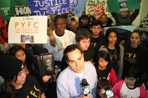 Pico Youth & Family Center founder Oscar de la Torre speaks to newscrews earlier this year before asking  the City Council to continue funding for the embattled center. (File photo)